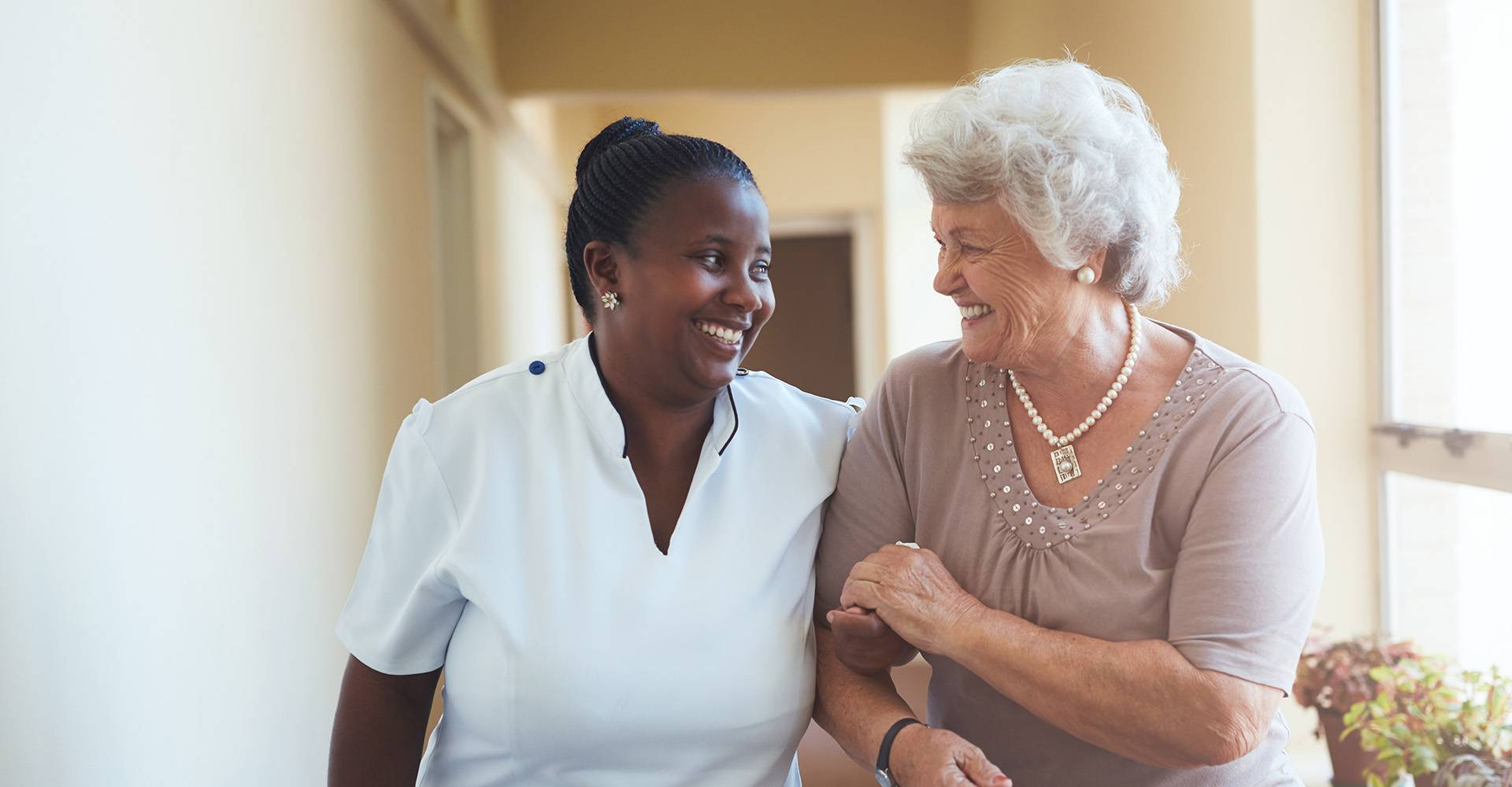 Health-care professional with elderly patient